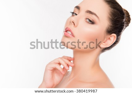 Beautiful healthy young woman om white background touching neck