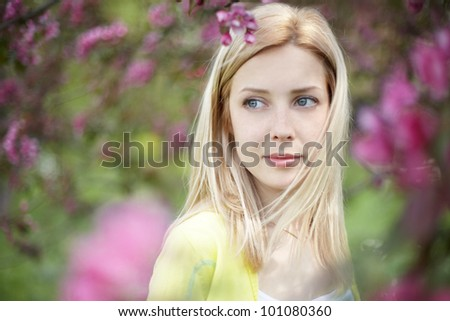 Beautiful healthy young woman with spring flowers - stock photo