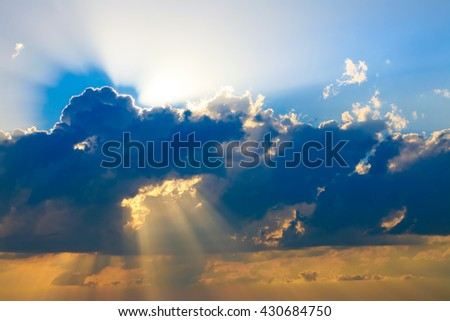 beautiful heavenly landscape with storm clouds and the sun - stock photo
