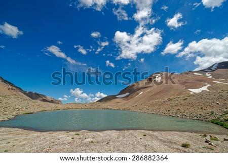 Beautiful high altitude lagoon on Domuyo Provincial Park, Neuquen, Argentina - stock photo