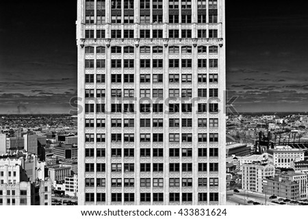 Beautiful high building with Windows in black and white - stock photo