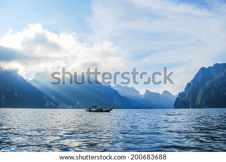 Beautiful high mountains and green river in the morning at Ratchaprapha Dam, Khao Sok National Park, Surat Thani Province, Thailand