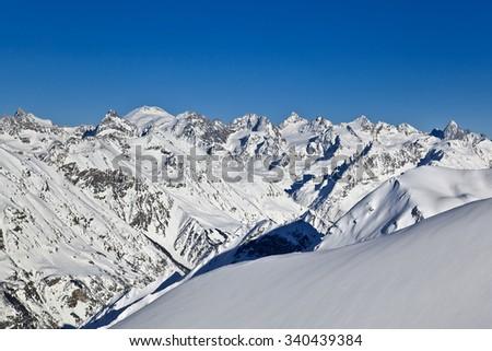 Beautiful high snowy mountains in winter. Mountain ski resort. - stock photo