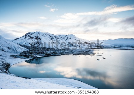 Beautiful highland iceland blue lake near Hekla among snow mountains. - stock photo