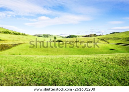 beautiful hill in counrtyside, with blue sky and clouds