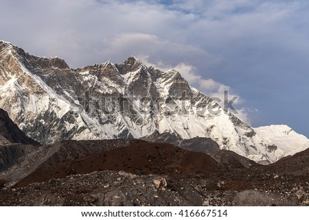 Beautiful Himalaya mountains on a cloudy day. Lhotse mountain south face view from Everest Base Camp Trek. Himalaya mountains landscape in Sagarmatha National Park in the Nepal. Himalaya mountains. - stock photo