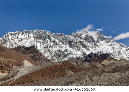 Beautiful Himalayan mountain range on a bright sunny day. Lhotse and Nuptse mountains range view from Everest Base Camp Trek. Mountain range landscape in Sagarmatha National Park in the Nepal. - stock photo