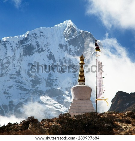 Beautiful himalayas with buddhist stupa and prayer flags near Thame village in Khumbu valley, Solukhumbu, Sagarmatha national park, Nepal - stock photo
