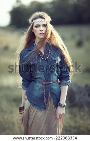 Beautiful hippie girl on nature. Boho fashion style - stock photo