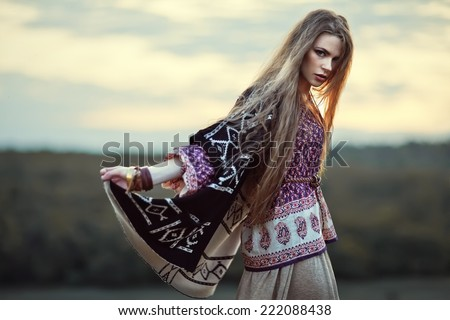 Beautiful hippie girl outdoors at sunset. Boho fashion style - stock photo