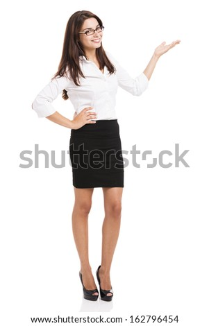 Beautiful hispanic business woman smiling over a white background presenting something