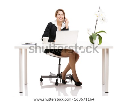Beautiful hispanic business woman working in the office, isolated over a white background - stock photo