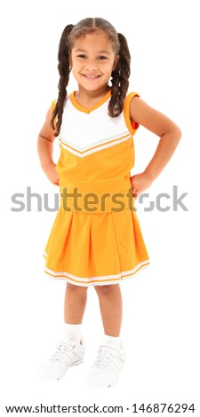 Beautiful hispanic cheer leader in uniform standing over white background with clipping path. - stock photo