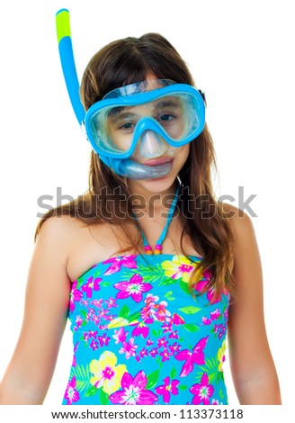 Beautiful hispanic girl with a diving mask and snorkel isolated on white - stock photo