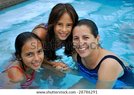 Beautiful Hispanic Mother and her two daughters
