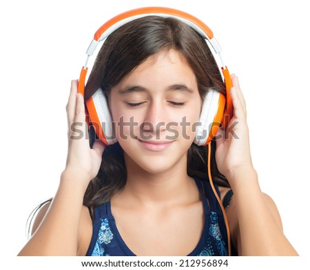 Beautiful hispanic teenage girl enjoying music on bright orange headphones with her eyes closed - stock photo