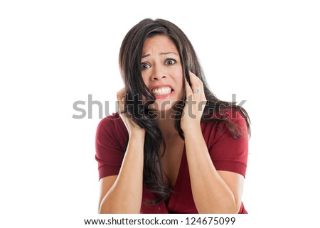 Beautiful Hispanic woman pulling hair scared and frustrated isolated on a white background