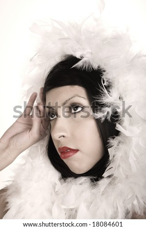 Beautiful Hispanic Woman with Feather Boa in Muted Pastel Colors - stock photo