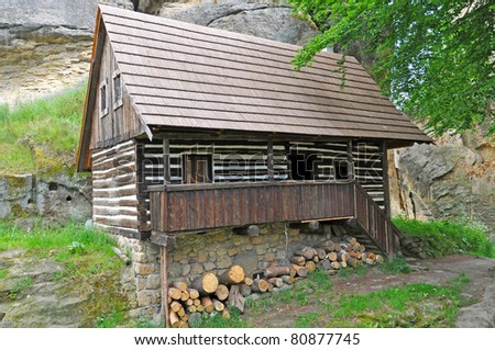 Beautiful historic log house during the sunny day. - stock photo