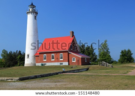 Beautiful historic Tawas lighthouse in Michigan, also known as Ottawa Point, built in 1853 - stock photo