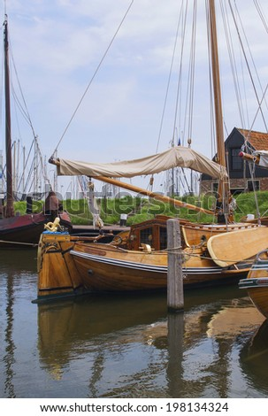 Beautiful historic wooden sailing yacht in the Netherlands - stock photo