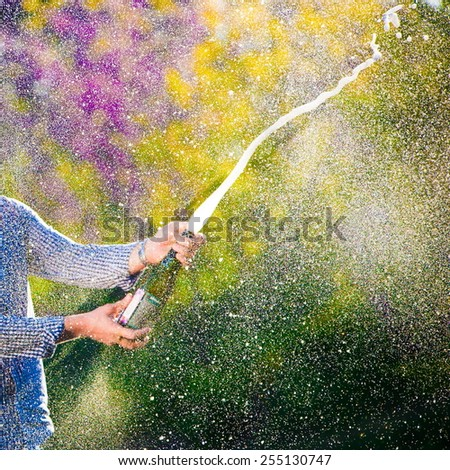 beautiful holiday bottle champagne spray explosion background spring honeymoon