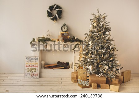 Beautiful holiday decorated room with Christmas tree with present boxes under it - stock photo