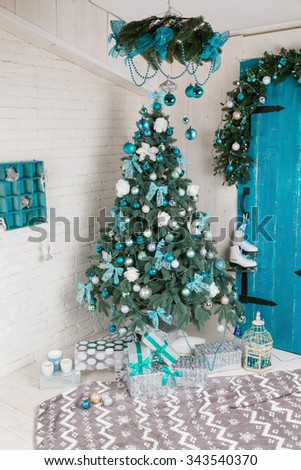 Beautiful holiday decorated room with Christmas tree with presents under it. Color blue - stock photo