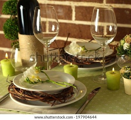 Beautiful holiday Easter table setting in green tones, on bright background  - stock photo