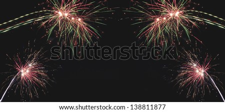 Beautiful  holiday fireworks on the black sky background, long exposure