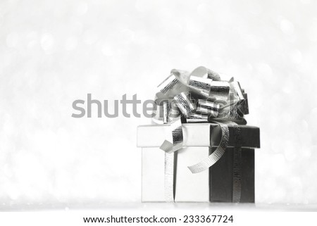 Beautiful holiday gift box decorated with silver bow - stock photo