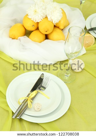 beautiful holiday table setting with lemons, close up