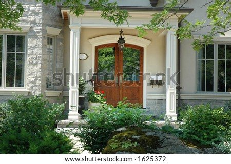 Beautiful home entrance / front doors made of wood - stock photo