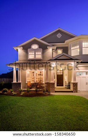 Beautiful Home Exterior at Night - stock photo