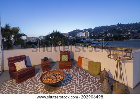 Beautiful Home Exterior Patio / rooftop at twilight  - stock photo