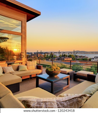 Beautiful Home Patio with Sunset View and Reflection - stock photo