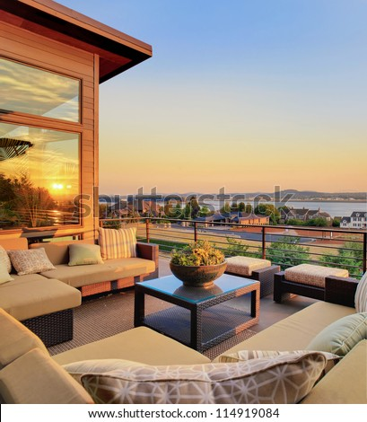 Beautiful Home Patio with View and Sunset Reflection - stock photo