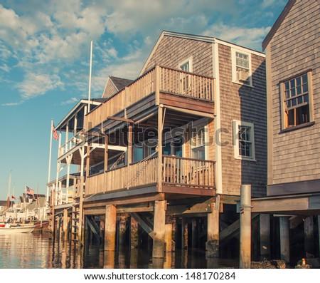 Beautiful homes over water at sunset, Nantucket, USA. - stock photo