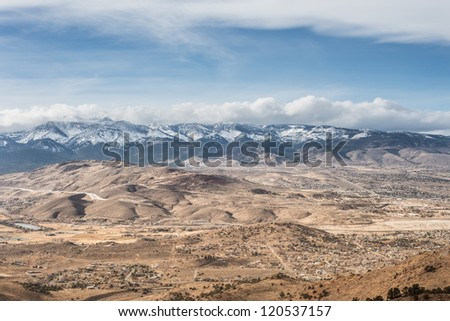 Beautiful horizontal shot of natural cloudy snowy mountain landscape