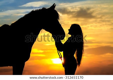 Beautiful horse with girl silhouette on sunset - stock photo