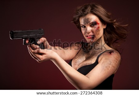 Beautiful, hot and sexy woman with gun. Riot girl.  - stock photo