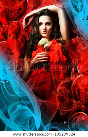 beautiful hot brunette woman in love in red dress around fabric - stock photo
