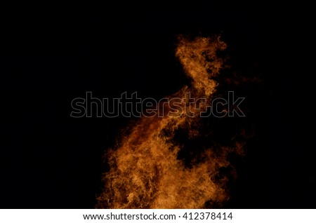 beautiful hot burning tall flames from bonfire on dark winter background - stock photo