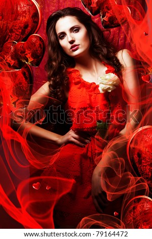 beautiful hot woman in love in red dress around fabric and hearts