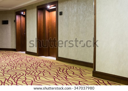 Beautiful hotel corridor with carpet - stock photo