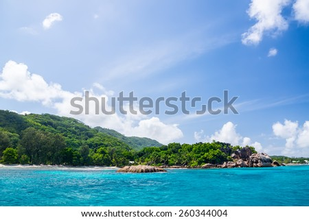 Beautiful hotel on the shore of the turquoise waters of the ocean. Surrounded by tropical greenery. The Seychelle,  d`ardgent island. - stock photo