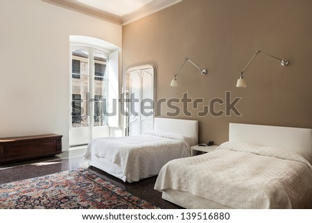 beautiful hotel room in historic building, suite - stock photo