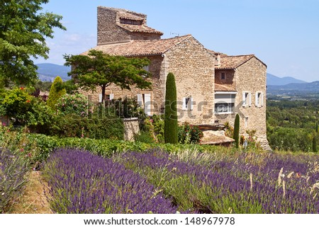 Beautiful house is situated near blooming lavender, Provence, France. - stock photo
