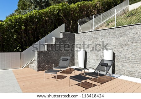beautiful house outside, modern style, two deckchair - stock photo