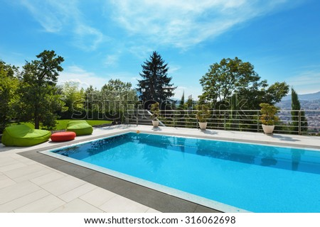 beautiful house, swimming pool nobody inside, summer day - stock photo